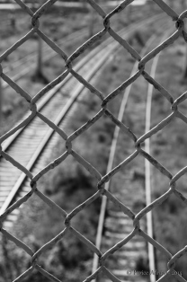 fence in front of train rails