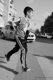 boy running on a crosswalk