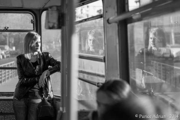 young girl's reflections in a tram