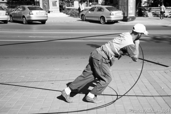 worker pulls a cable
