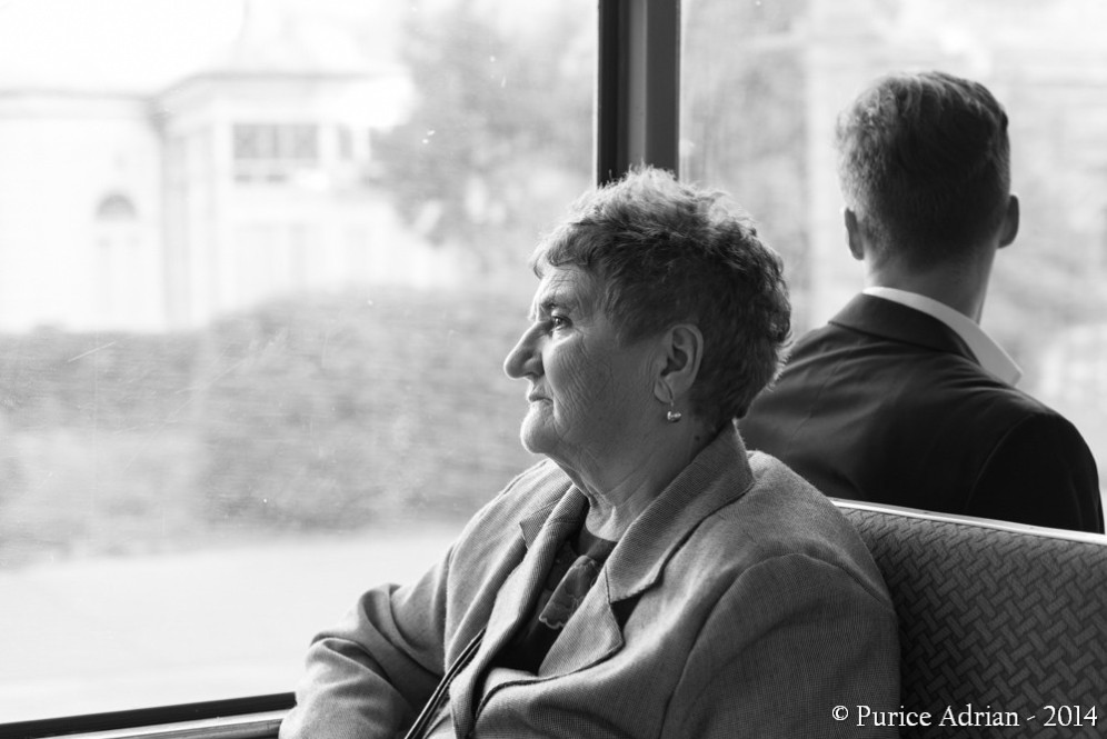 passengers on a bus sitting back to back