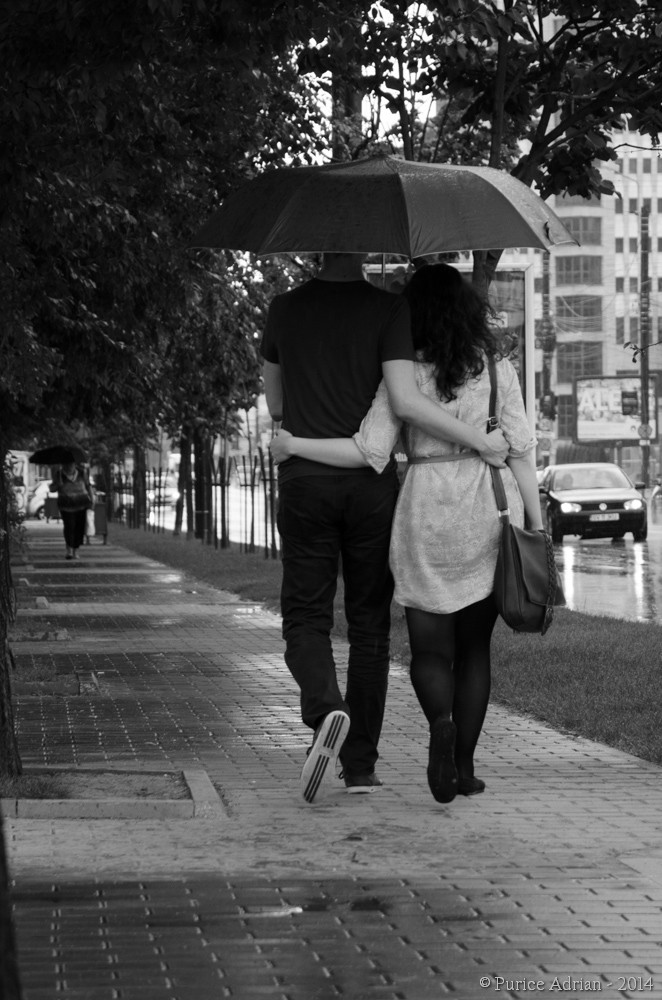 couple walking in the rain