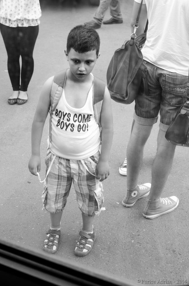 message on a boy's shirt