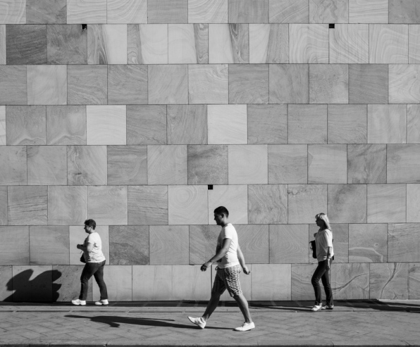 3 persons vs triangle on a wall