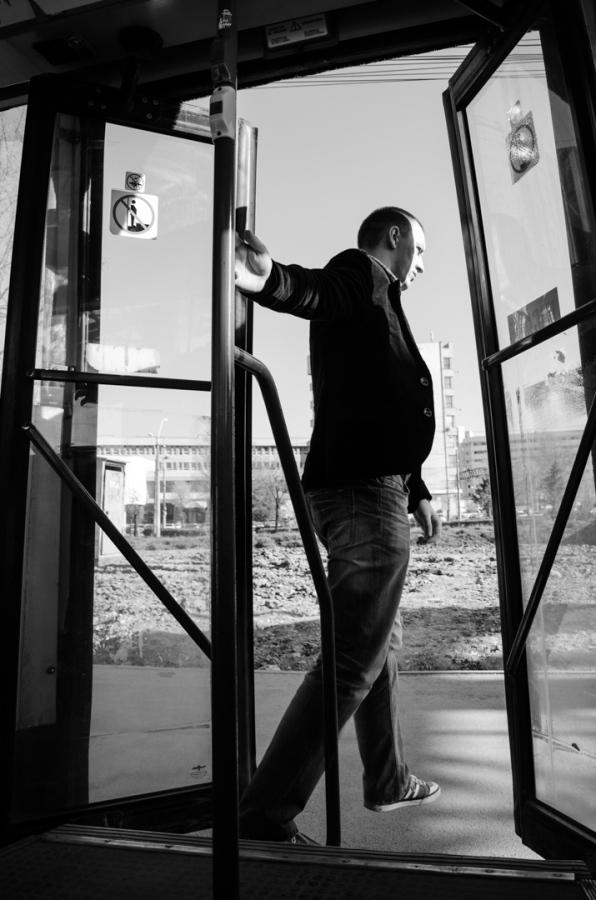 man stepping off a bus