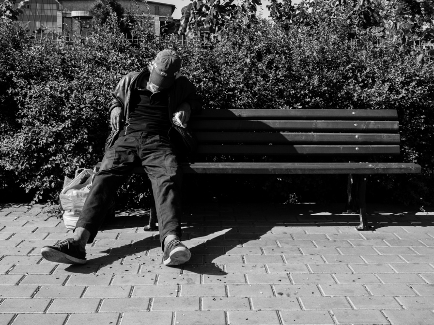 guy resting on a bench