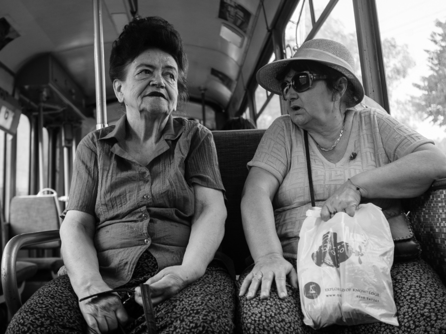 old women chatting in a tram