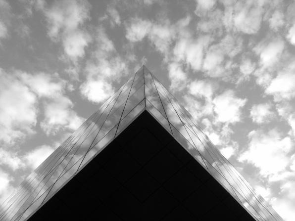 sky reflection on glass facade