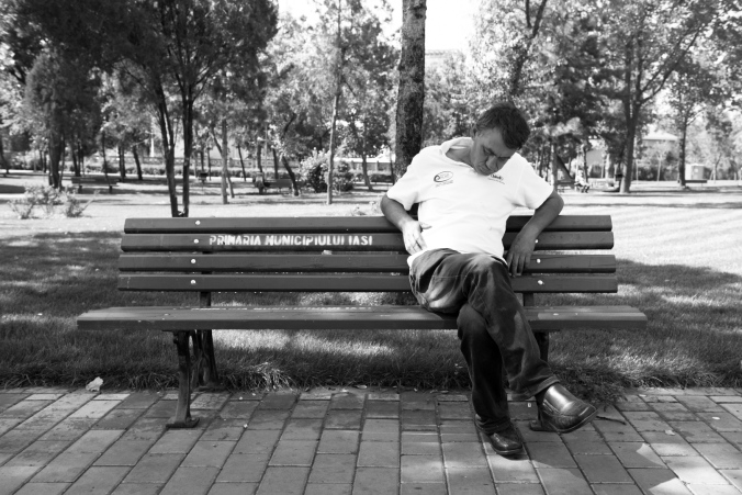 old guy sleeping in a park