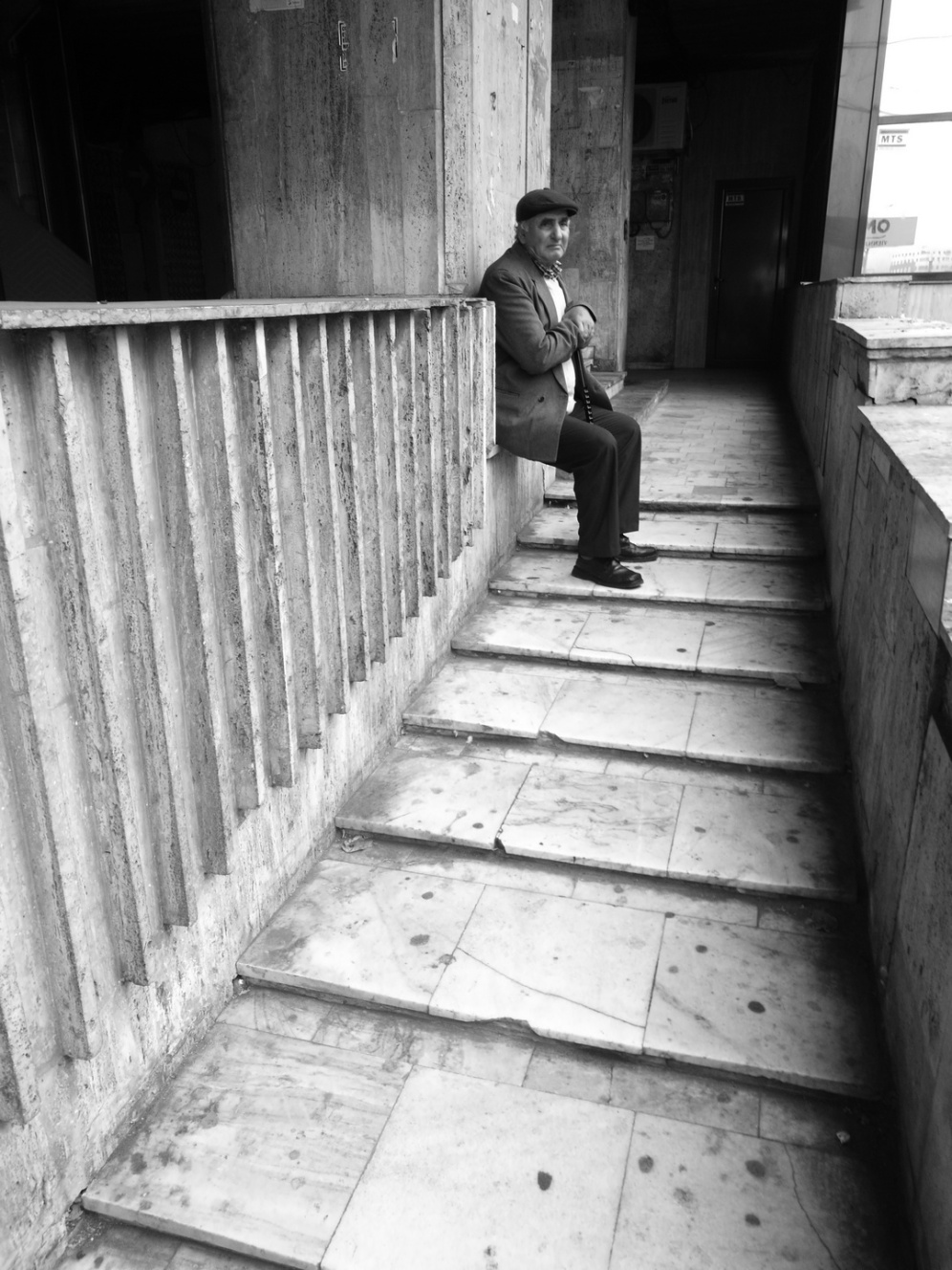 old guy waiting on the stairs