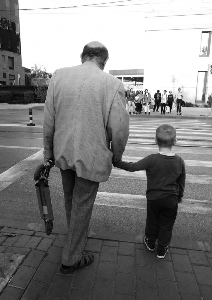 boy going to the playground with grandpa
